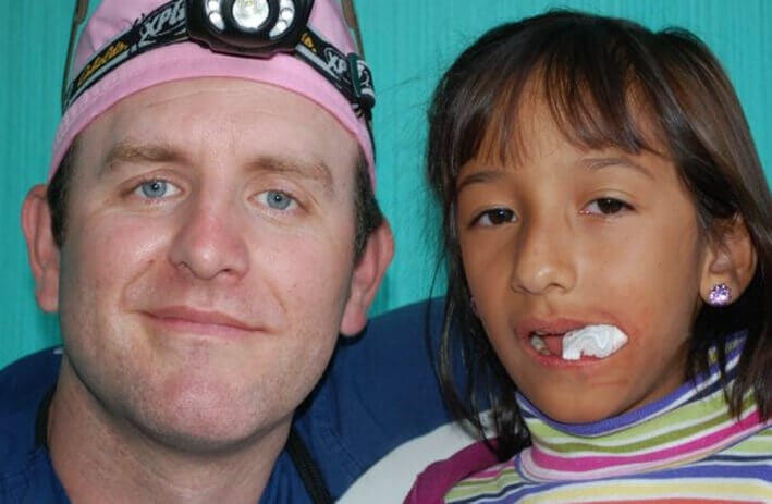 Glastonbury dentist, Dr. John Carroll with Guatemala patient